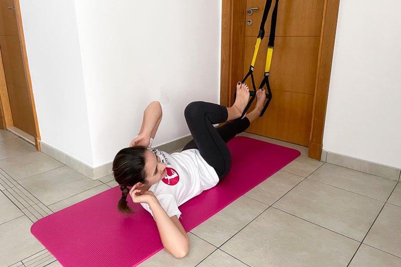 beste Sling Trainer Bauchübung - Side Crunches